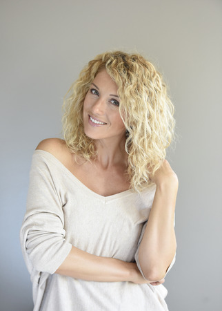 65500580 - portrait of attractive woman with long curly hair, isolated